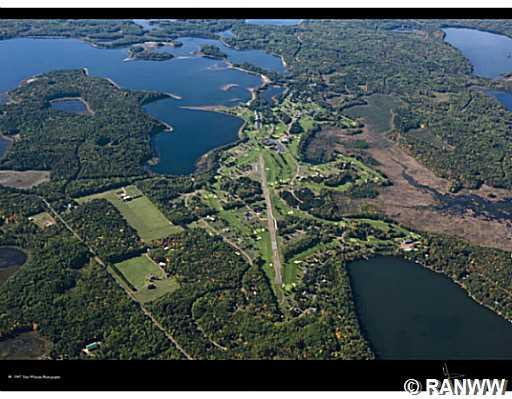 Aerial View. The heart of Voyager with the airstrip, golf courses, and clubhouse. Birch Island Lake is upper left. - Lot 66 Winter Green Way Danbury