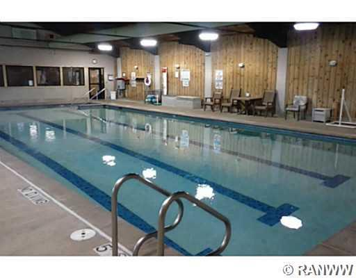 Swimming Pool/Hot Tub/Sauna. Indoor pool is open year round and heated to 83 degrees. Fitness center is behind the windows at the far end of the pool. - Lot 66 Winter Green Way Danbury
