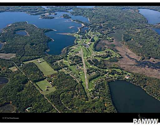 Aerial View. The heart of Voyager s 5,200 acres with the airstrip, golf courses, and clubhouse. - Lot 79 Tall Moon Circle Danbury