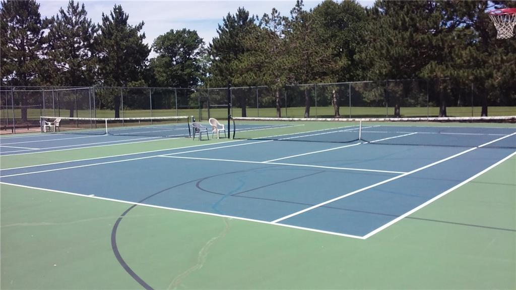 The tennis courts also have lines and nets for basketball. There is an informal league that plays on Mon/Wed/Fri morning in season. - Lot 20 Wintergreen Trail Danbury