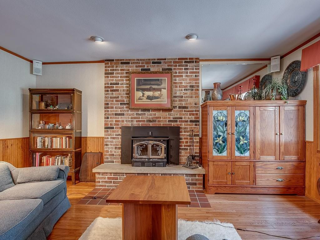 Cozy up to the wood burning fireplace in this one of two main floor family rooms! - E4505 479th Avenue Menomonie