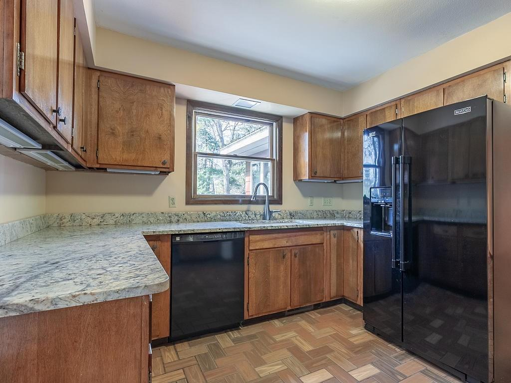 Main kitchen with granite counters! (There are two kitchens in this home) - E4505 479th Avenue Menomonie