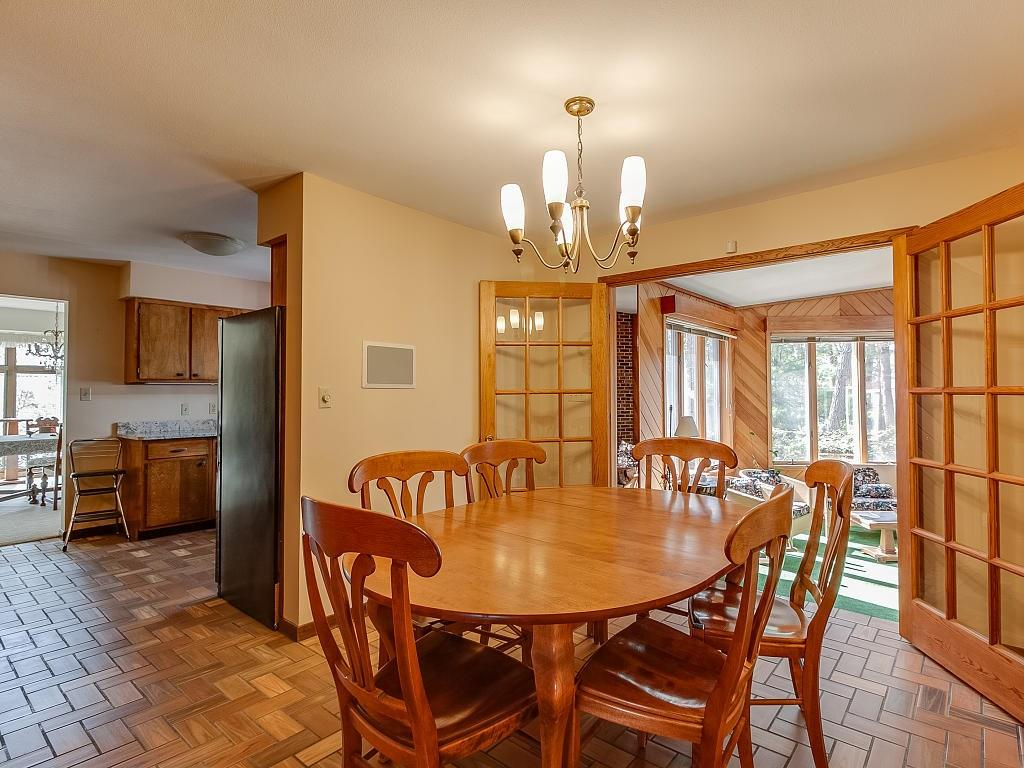 In-formal dining off kitchen - french doors lead to spa room! - E4505 479th Avenue Menomonie