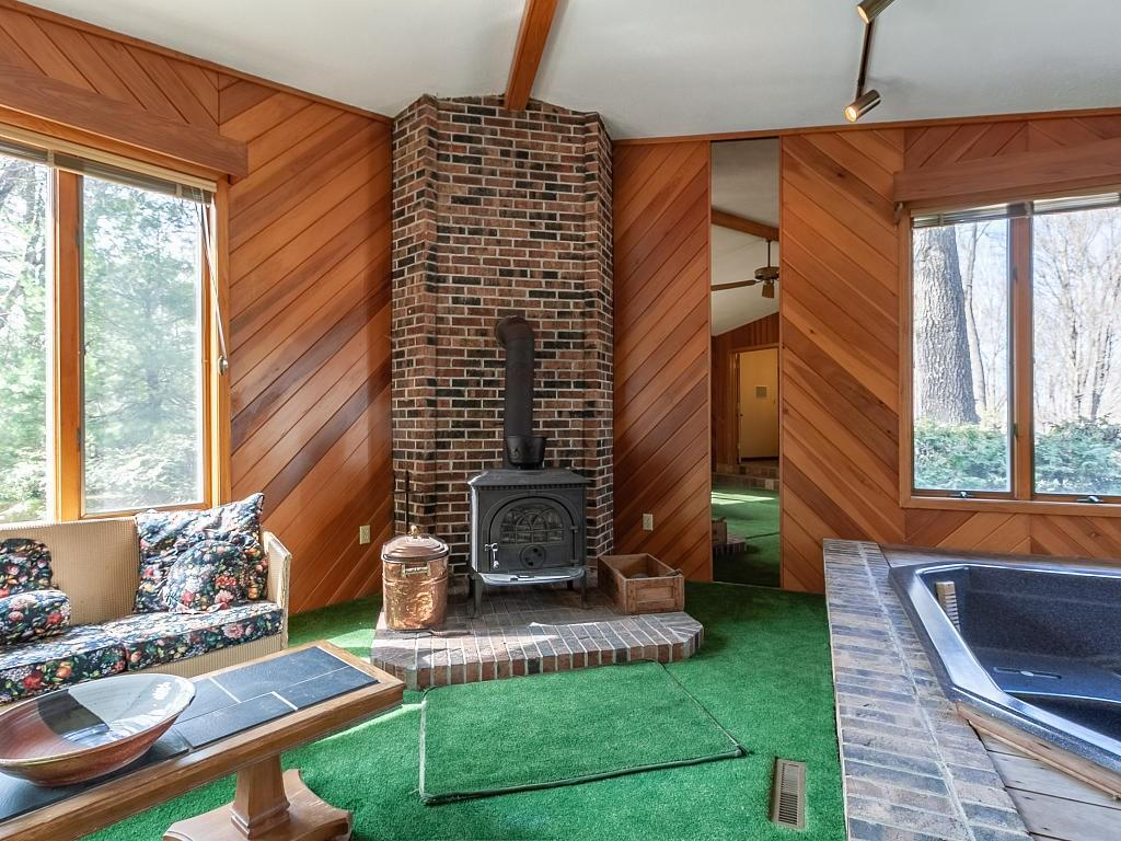 Spa room with free standing wood stove and hot tub! - E4505 479th Avenue Menomonie