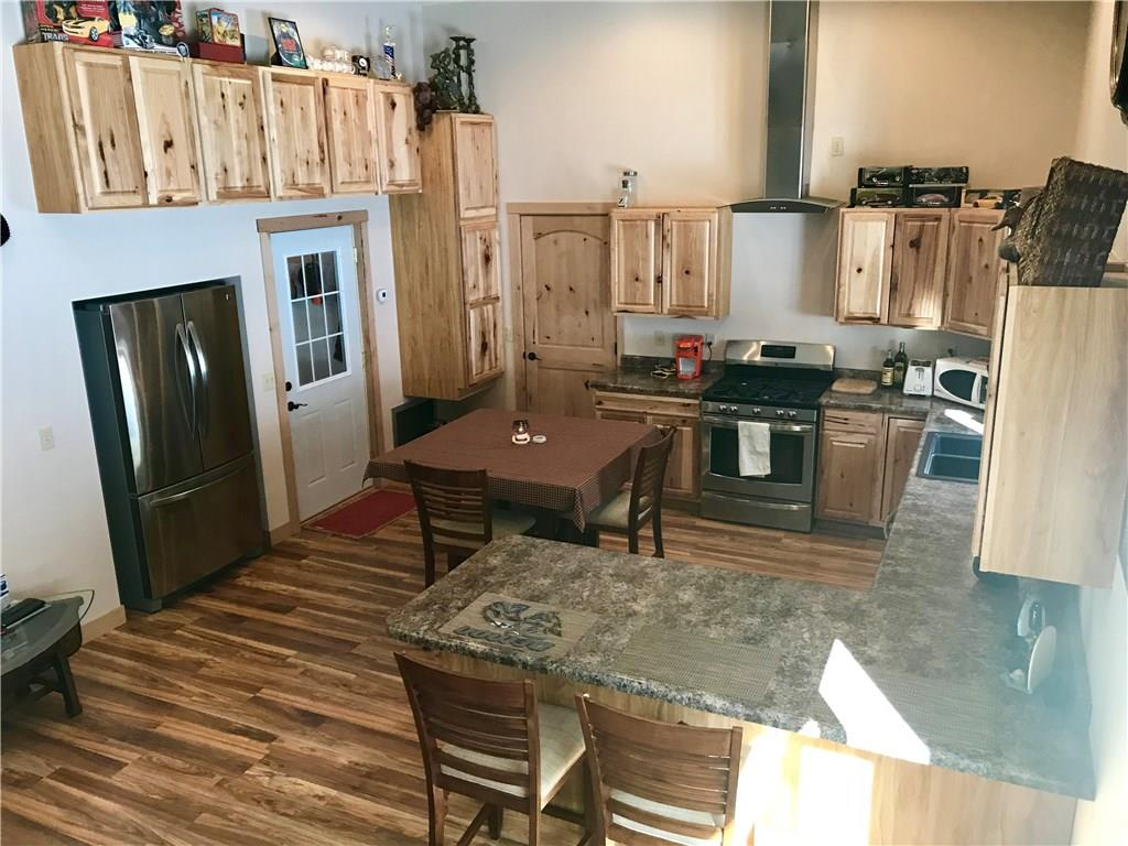 Beautiful hickory cabinetry and all stainless appliances included. Breakfast counter seating. - E7108 County Road S  Wheeler