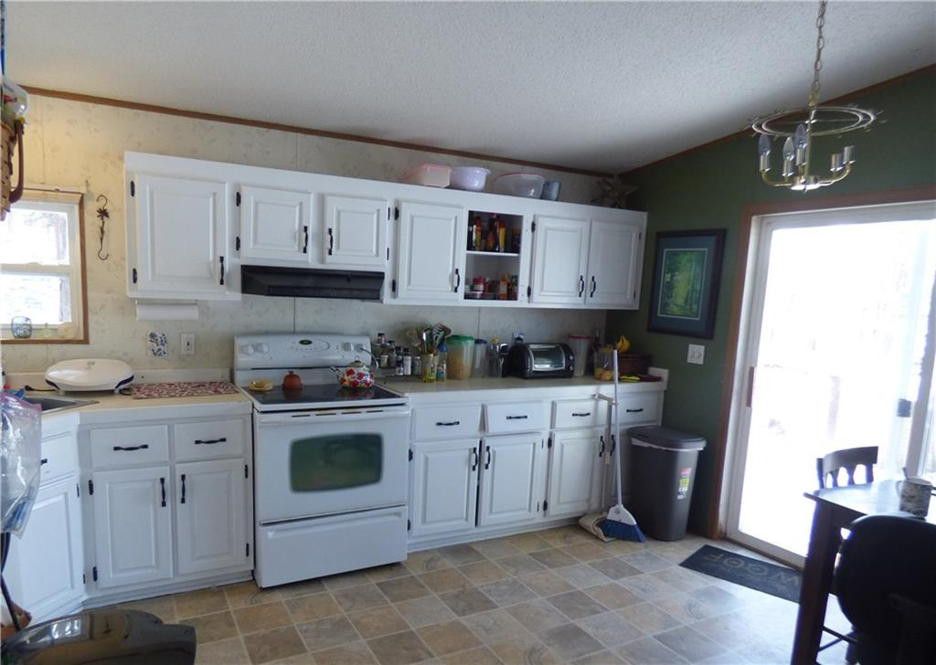 lakeside kitchen with access to front deck - 15003W Adina Lake Drive Hayward