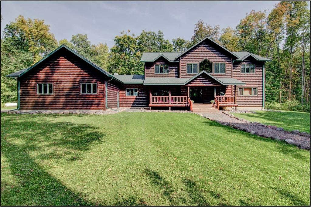 STUNNING newer 5 Bedroom / 5 Bath log sided home tucked back on a 20.5 acre parcel that includes a mixture of woods and open field / meadow. Incredible picture windows, dramatic log finishes, large go - 2736 27 1/2 Avenue Birchwood