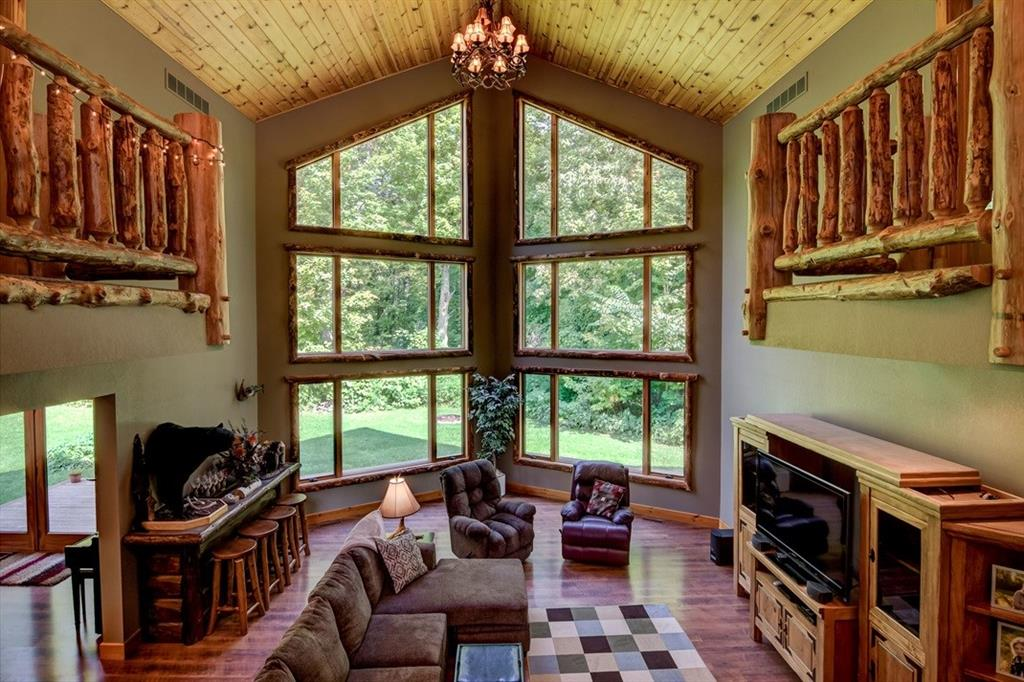Soaring picture windows w/incredible log accent detail throughout the home! - 2736 27 1/2 Avenue Birchwood