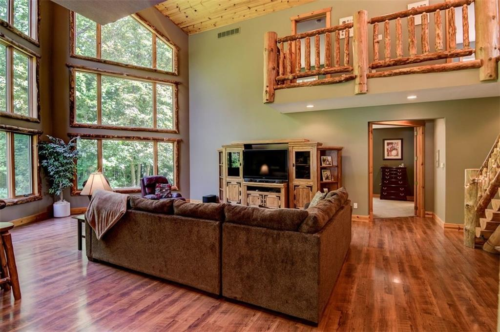 Notice the upstairs balcony area overlooking the great room! The intricate log detail is amazing! - 2736 27 1/2 Avenue Birchwood