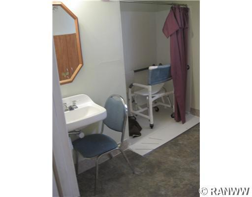 Bathroom. Accessible shower. - 251 Woodard Street Chetek