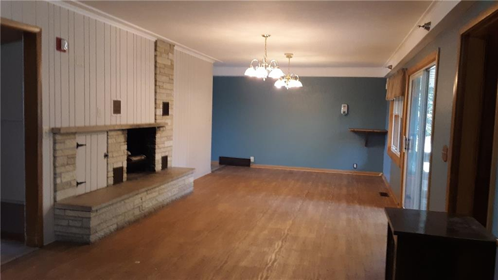 Living room with fireplace. - 251 Woodard Street Chetek