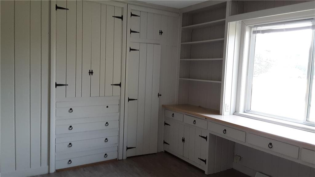 Bedroom with built in storage and desk area. - 251 Woodard Street Chetek