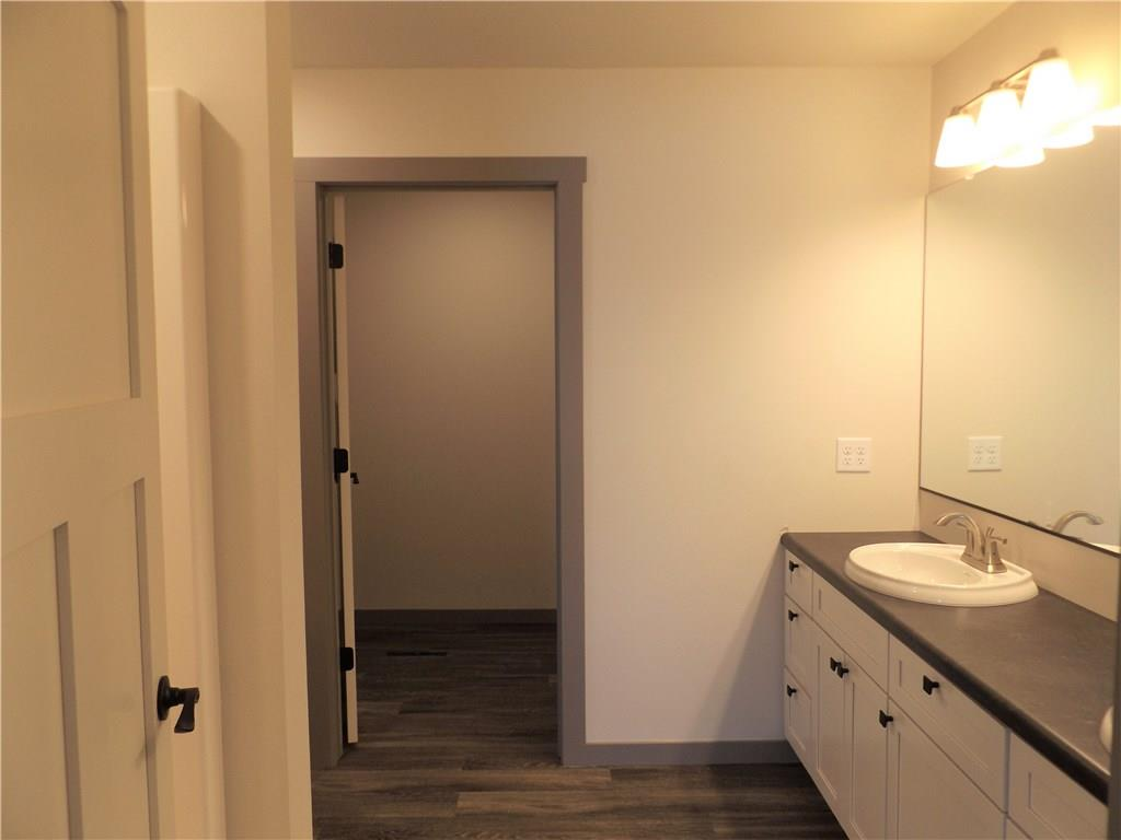 master bath with double sinks, walk in shower, & walk in closet - 1967 Tucker Trail Eau Claire