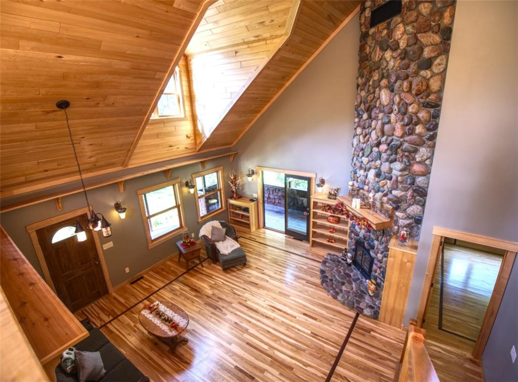 loft view of living/great room with 21' fire place - 15899 156th Street Bloomer