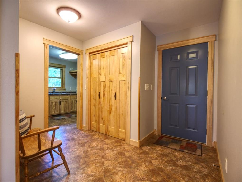 door to garage and coat/ foyer leading to laundry room. - 15899 156th Street Bloomer