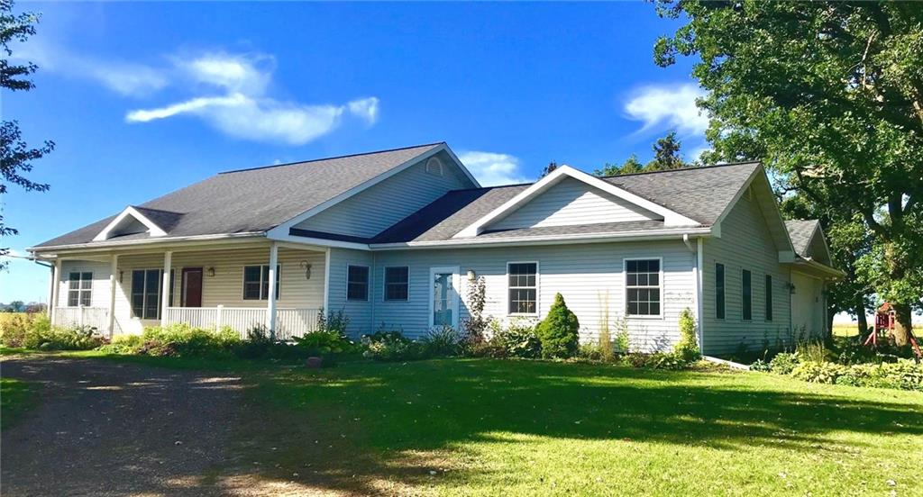 Beautiful country ranch home located NE of Menomonie on Cty Road E North surrounded by a grove of oak trees on 3.41 acres. Home features 3008 Sq. Ft. of living area ww/ (5) bedrooms, (3) baths, gas fi - E6980 County Rd E  Menomonie