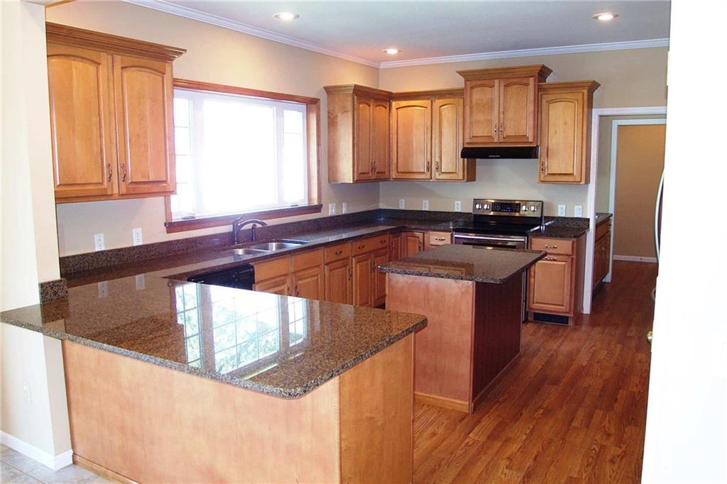 Beautiful granite countertops in the kitchen area. Breakfast counter seating! Stainless appliances. - E6980 County Rd E  Menomonie