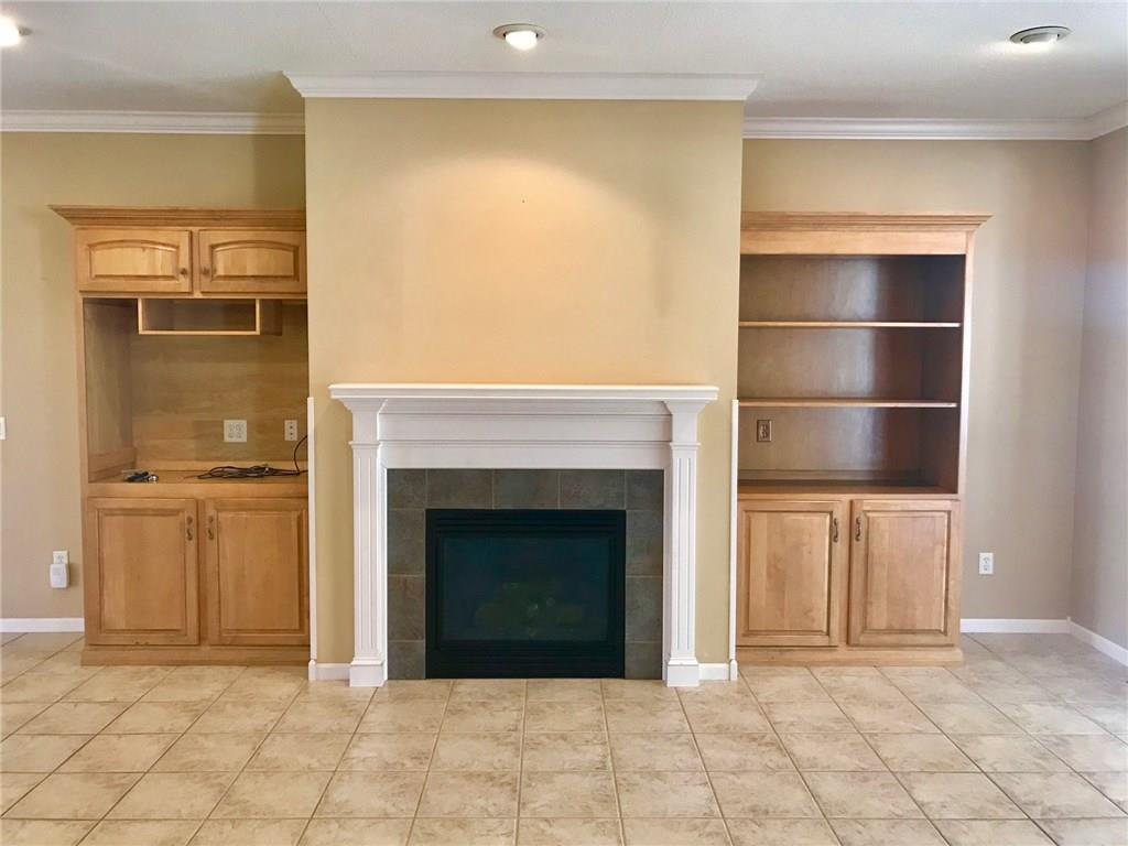 Gas fireplace with built ins surrounding in the living room area! - E6980 County Rd E  Menomonie