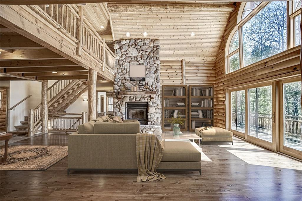 Full log home with a 20' peak and a wall of windows to the lake. - 50510 Martin Road Solon Springs