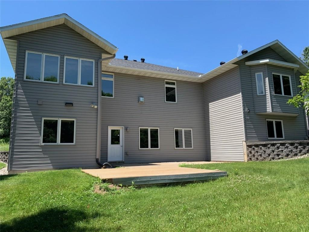 Walk out basement to deck. Sunroom & Office on right, En Suite bump out on left. - 3635 Ridgeway Drive Eau Claire