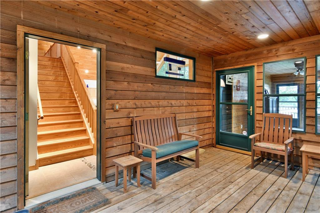 Screened in porch with an attached three season room - N2904 Jesse Road Sarona