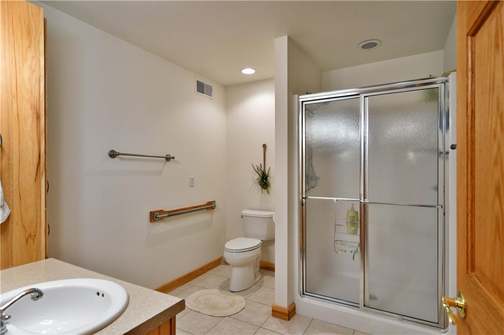 Master bathroom with a walk in shower. - N2904 Jesse Road Sarona