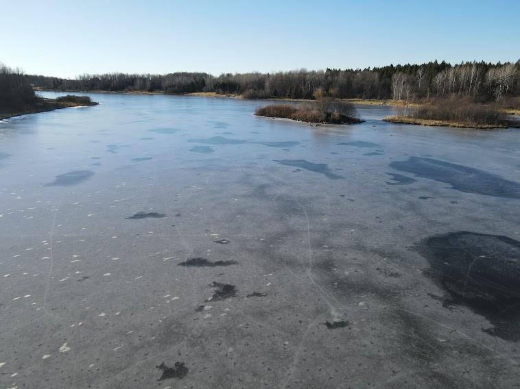 Frozen Lake LaVerne looking down lake - W2222 Penny Lane Hawkins