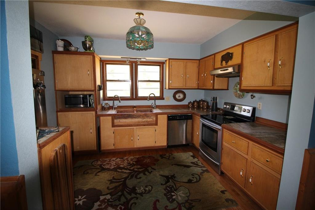 Remodeled kitchen, wood floors and new appliances. - N7650 Pow Road Springbrook